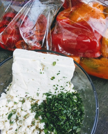 Mixing the herbed feta while the peppers marinate