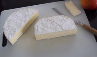 Cut cheese in half; remove the rounded corners off the brie.