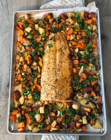 Sheet pan salmon, roasted and sprinkled with fresh kale.