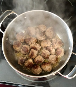 Brown the meatballs in the Dutch oven.