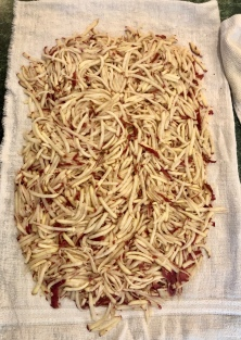 Place the hash browns on a towel, cover with another towel and press hard to squeeze out the extra juice.