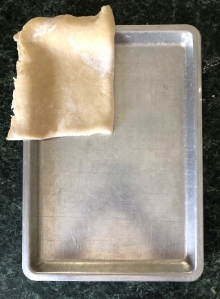 Fold pastry in quarters. Unfold and carefully fit into pan.